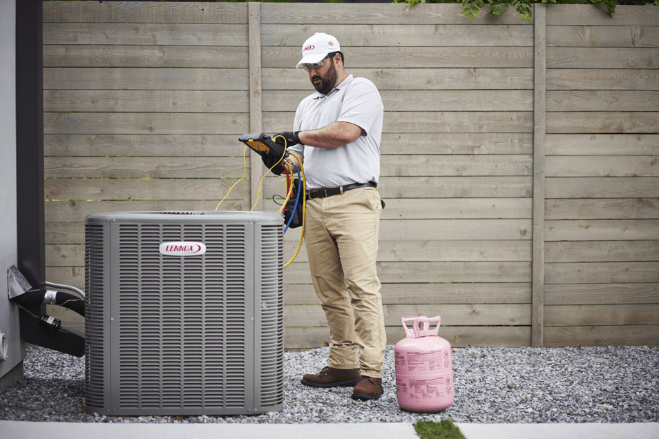 Technician assessing a Lennox heating unit